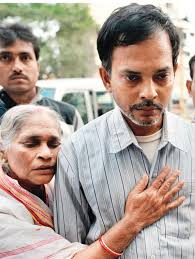 Jyotirmoy Nandi with his mother Chitra Nandi on being released from police custody on 06 December 2013.