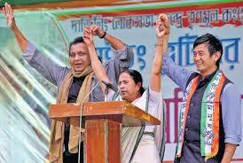 Trinamul Darjeeling candidate Baichung Bhutia in 2014 poll campaign with Mamata Banerjee and Mithun Chakraborty.
