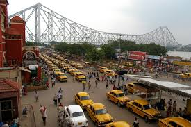 Taxis line up in front of Howrah railway station.