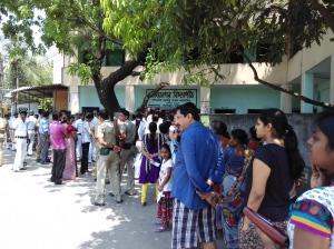 Falnked by policemen, voters queue up at Ajoynagar Vidyapith in KMC ward no 109.