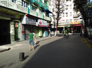 Children playing cricket on Madan Street in central Kolkata.