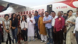 Bengal Youth Affairs Minister Aroop Biswas (in white panjabi) and Labour Minister Moloy Ghatak (in yellow panjabi) along with Bengali film actors in front of the inaugural flight at Kazi Narul Airport at Andal near Asansol on Monday.